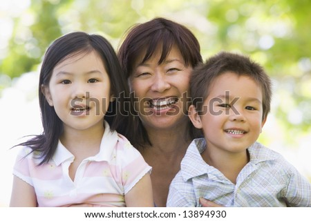 Grandmother laughing with grandchildren - stock photo