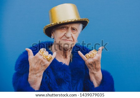 Grandmother portraits on colored backgrounds. Funny moments with a granny woman. Lifestyle and people concepts