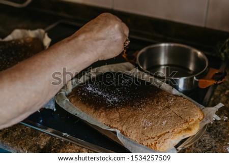 grandmother preparing the cake or homemade cake