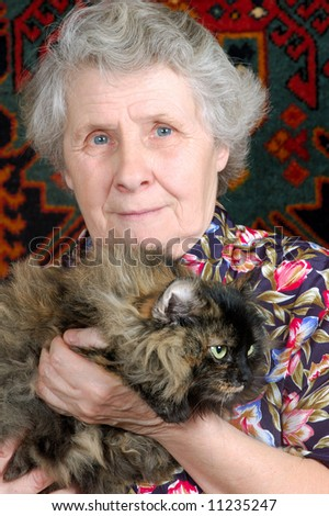 grandmother sitting with cat on her hands