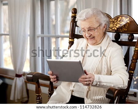 Grandmother Using Tablet Computer