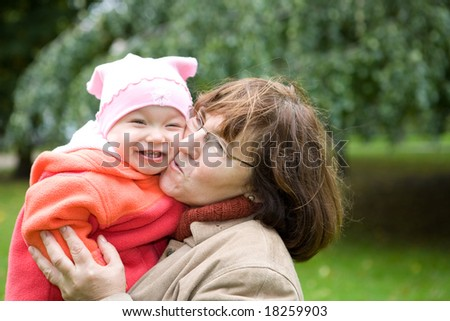 grandmother with baby girl together in park