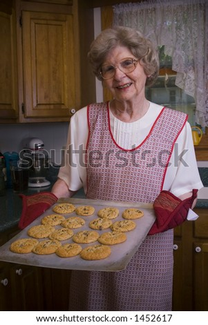 Grandmother with freshly baked chocolate chip cookies.