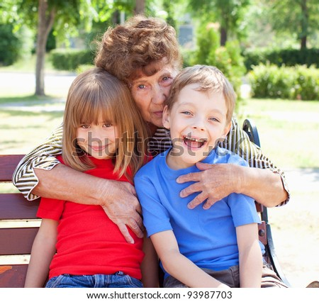 Grandmother with grandchild. Old woman with children