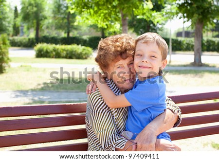 Grandmother with grandchild. Old woman with grandson
