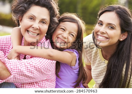 Grandmother With Granddaughter And Mother In Park #284570963