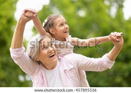 Grandmother with granddaughter  in park Foto stock ©