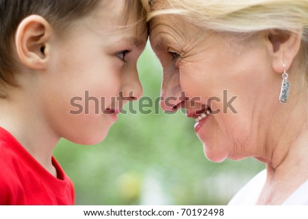 Grandmother with grandson on nature face to face
