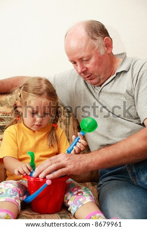 Grandpa and grand-daughter playing
