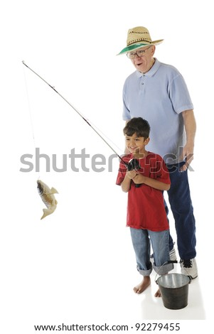 Grandpa's impressed by the fish his preschool grandson caught.  On a white background.