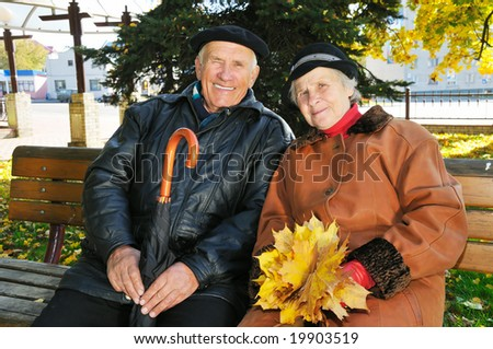 grandparent on bench in park