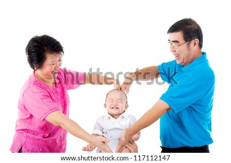 grandparent playing with their grandson