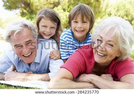 Grandparents And Grandchildren In Park Together