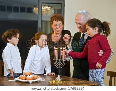 grandparents and grandchildren lightening Menorah  together