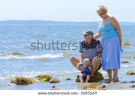 Grandparents at the beach with their grandson