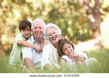 Grandparents In Park With Grandchildren