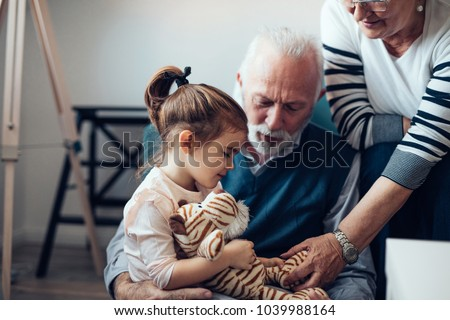 Grandparents playing with their granddaughter Foto stock ©