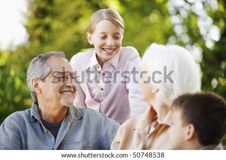 Grandparents with Grandchildren in back yard