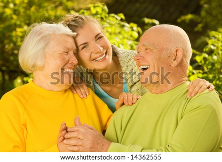 Grandparents with granddaughter outdoors