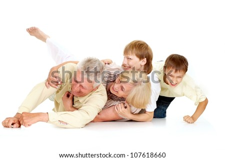 Grandparents with their attractive  grandchildren on a white background