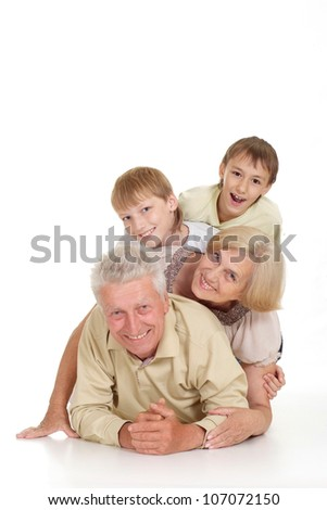 Grandparents with their beauteous grandchildren on a white background