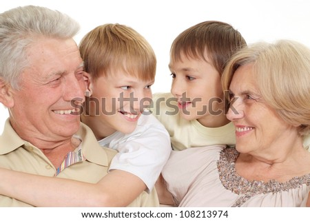 Grandparents with their good grandchildren on a white background