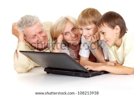 Grandparents with their happy  grandchildren on a white background