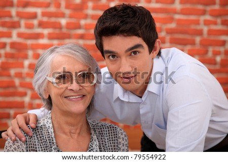 Grandson and grandmother in restaurant - stock photo
