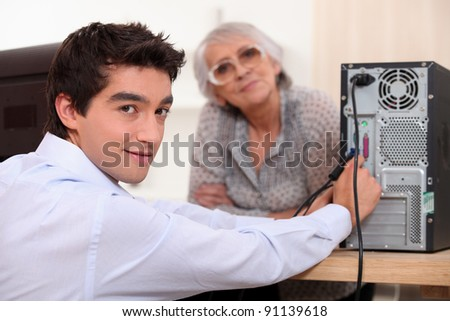 Grandson setting up computer