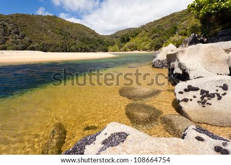 Granite boulders and sandy beach in Abel Tasman National Park, South Island, New Zealand