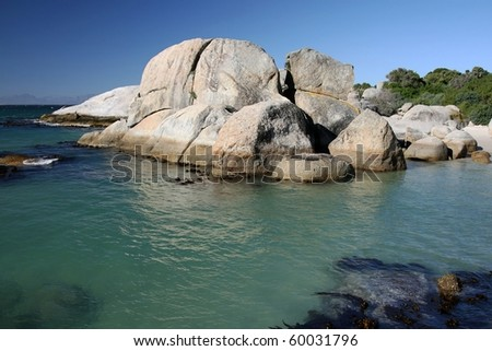 Granite boulders and turquoise sea water on the coast in South Africa