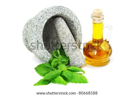 Granite mortar with fresh basil and olive bottle on white background. - stock photo