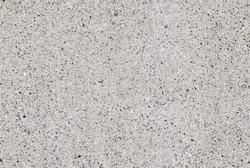 Granite mosaic texture, cement floor background. White granite pebbles stone on the cement texture