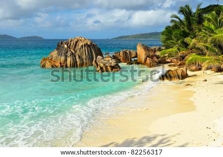 Granite rocky beaches on Seychelles islands, La Digue. Evening light - stock photo