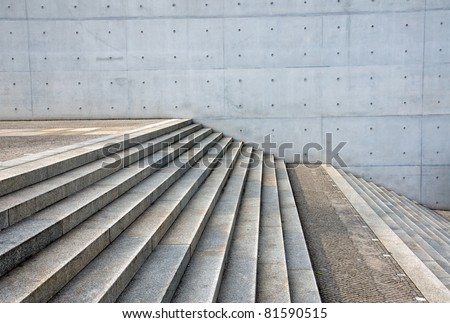 Granite stairs and a concrete wall #81590515