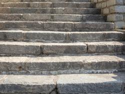Granite stone stairs. Old vintage granite texture stairway. Grey Grunge blocks stairs.