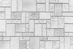 Granite white stone block walls pattern and seamless background