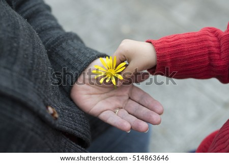 Granny and granddaughter handing flower