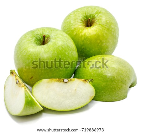 Granny Smith apples, two whole, sliced and one half, isolated on white background