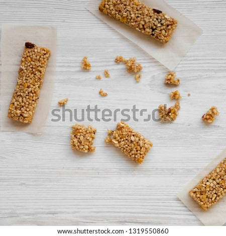 Granola bars on baking sheet on a white wooden table, top view. Overhead, from above, overhead. #1319550860