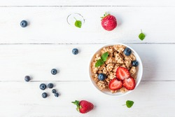 Granola. Healthy breakfast with muesli and berries, top view, flat lay