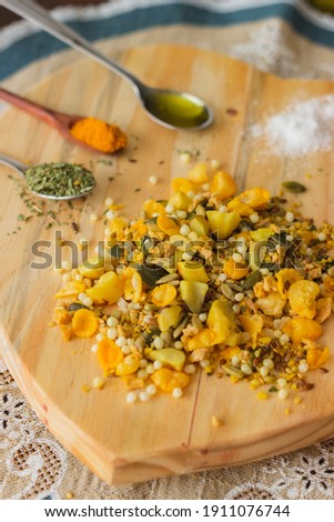 Granola - Is a breakfast cereal usually consisting of oats, wheatgerm, sesame seeds, and dried fruit or nuts Stock photo ©