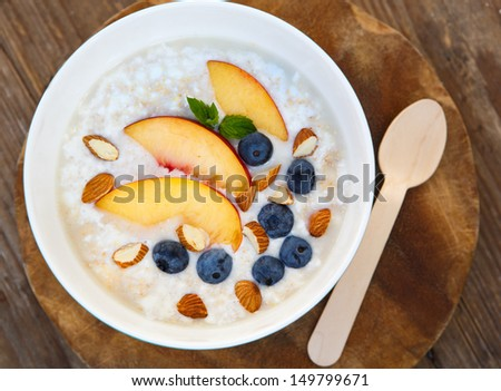 Granola with fresh organic blueberries, nectarines and almonds. Healthy breakfast