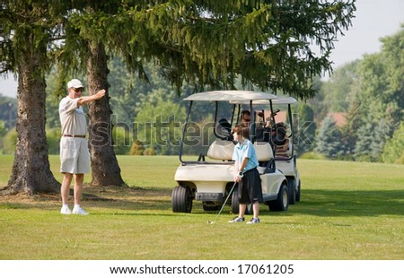 Granpa Instructing Grandson in Golfing