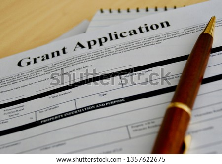 grant application with pen #1357622675