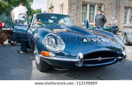 GRANTOWN ON SPEY, SCOTLAND - SEPTEMBER 2: Jaguar E Type on display in the annual Motor Mania car show on September 2, 2012 in Grantown On Spey, Scotland