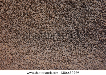 Granulated black and brown tea closeup background texture. Granulated teas are being sold in the street of Delhi India