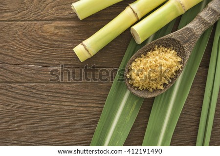 granulated brown sugar produced from sugar cane, top view. Agriculture Industry concept.