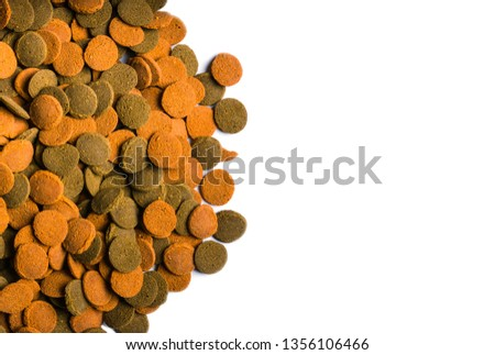 granulated food for aquarium fish on white background