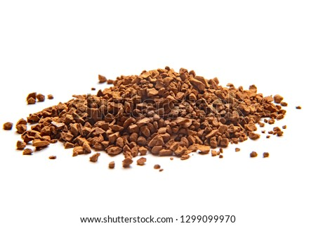 Granulated sublimated dry particle coffee on white background